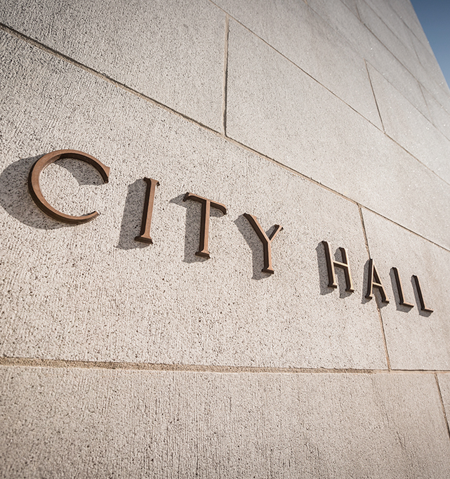 A sign outside city hall.
